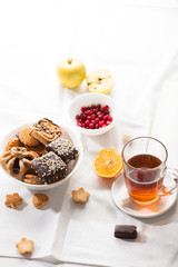 Tea and sweets on white background