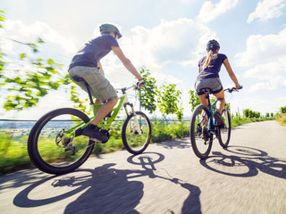 Young Couple Riding Their Mountain Bikes