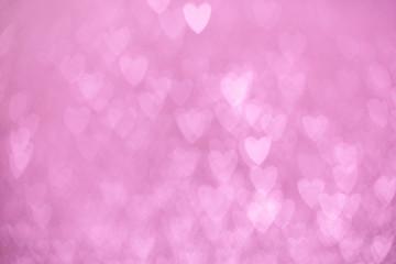 defocused lights bokeh background of pink hearts