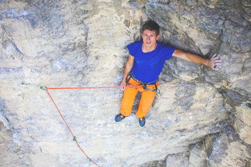 Rock climber resting on a rock.