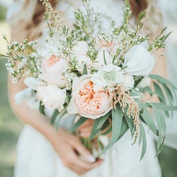 Beauty wedding bouquet in bride's hands
