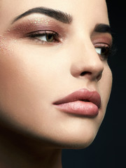 Beauty Make-up with glitter eye shadows