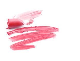 Smudged pink lipstick isolated on white background