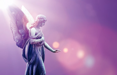 Angel in heaven over purple sky background Wall mural