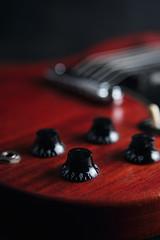 Parts of reg electric guitar, close-up shot