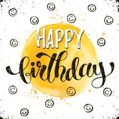 Happy birthday text hand drawn with dry brush. Bright and modern ink lettering for greeting cards design. Birthday phrase with smileys on white background.