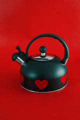 Stovetop whistling kettle with red hearts. Happy Valentines Day