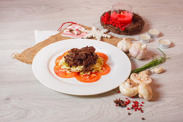 roasted meat with tomatoes on a beautiful decor