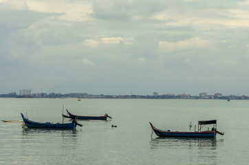 Fishing barges floating in the sea water at Penang, Malaysia.