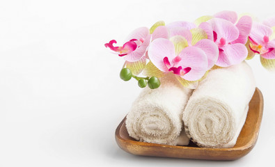 Spa setting with orchid flower and towels