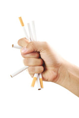 Male hand crushing cigarettes on white background