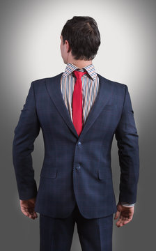 Man wearing his suit on backwards