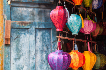 Hoi An, central Vietnam. The traditional Vietnamese silk lanterns on a background of the blue wall.