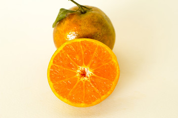 Ripe oranges isolated on white background. Orange in a cut