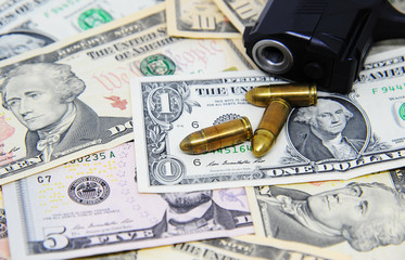 Dollar banknotes with pistols and gun