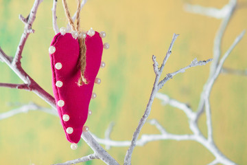 Heart from clothing on wood branch