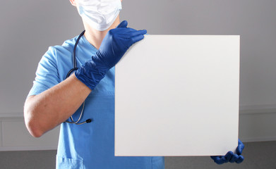 Doctor holding blank banner , standing on white background