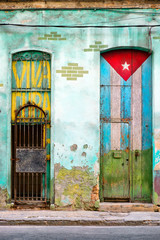 Old  house in Havana with a painted cuban flag