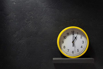 wall clock  at black background
