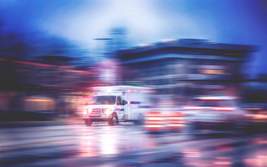 an ambulance racing through the rain on a stormy night with motion blur