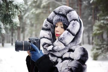 Winter forest girl photographer