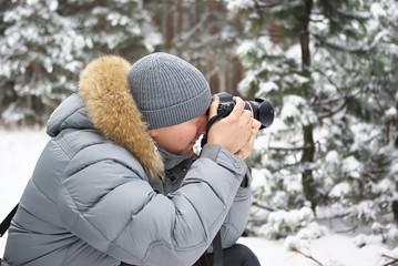 Winter forest man photographer