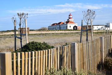 Lighthouse at Cabo Sardao in Alentejo, Portugal with Fence