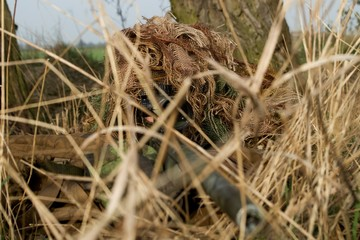 Sniper in camouflage suit
