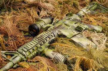 Camouflaged assault rifle and sniper suit
