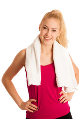 Woman resting after fitness workout with towel arounfd her neck