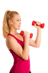 Cute young blond woman working out in fitness gym isolated over