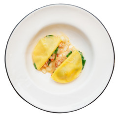 Ravioli-like dish with crayfish, apples and herbs isolated on wh