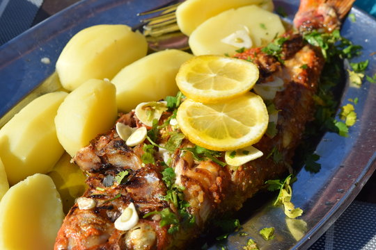 Grilled Seabeam with Potatoes and Lemon