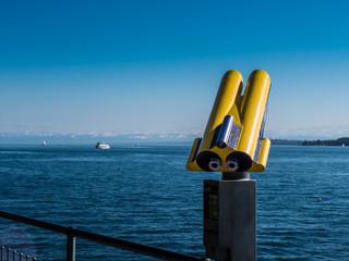Yellow Binoculars at a Lake
