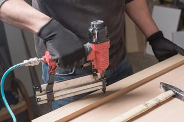 Carpenter making furniture in workshop