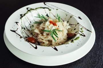 Pasta in cream sauce with caviar on a white dish