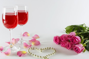 Wineglass with roses.