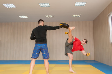 MMA fighter practicing high kick
