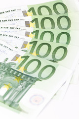 Close-up of One hundred euro banknotes on white background