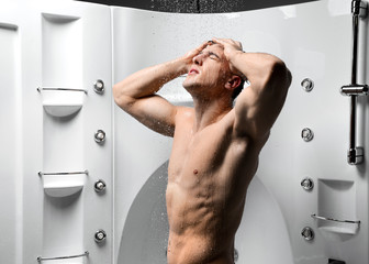 strong body man taking shower in new bathroom with hydro massage