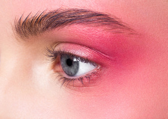 Beauty makeup pink eyes close up retouched skin