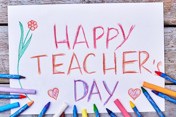 Colourful pencils, drawing, a flower. Happy Teacher's Day wish.