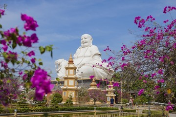 Maitreya Buddha statue located in the famous Vinh Trang pagoda in My Tho city, Tien Giang province, Vietnam.