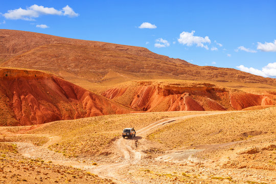Off-road car driving on a desertic landscape. Dades Valley, Morocco