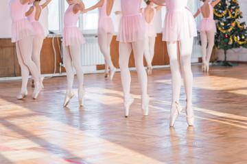 Ballerinas dancing in the ballet hall. Emotional children`s ballet. Soft focus