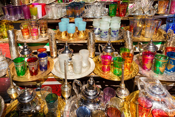 Colorfuln tea sets at a street market in the souk of Marrakech,