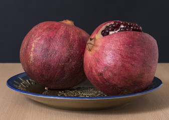Ripe pomegranate fruit and cutout