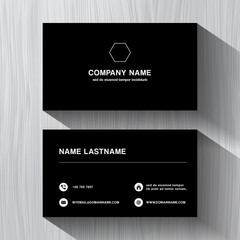 Black paper business namecard on a white wood background