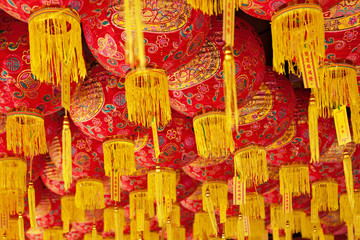 Group of traditional chinese red lanterns as decoration for China new year holidays in old taoist temple in Penang city. Malaysian people religions. Art, culture of Malaysia. Asian travel background