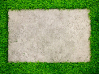 Square concrete plate on artificial green grass background